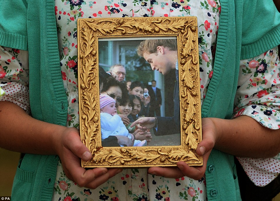 The photo shows the young royal greeting the girl, who at the time was only a few months old