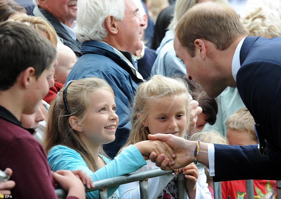 Greeting the locals: Prince William chats with children during a walkabout in Seymour Square in Blenheim, New Zealand on Thursday