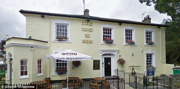Open for business: The pub in Truro, Cornwall, ordered in the sign huge white boards were erected outside