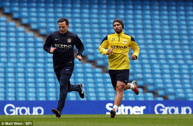 Fighting fit? Aguero warmed up ahead of City's 4-1win over Southampton last weekend but did not feature