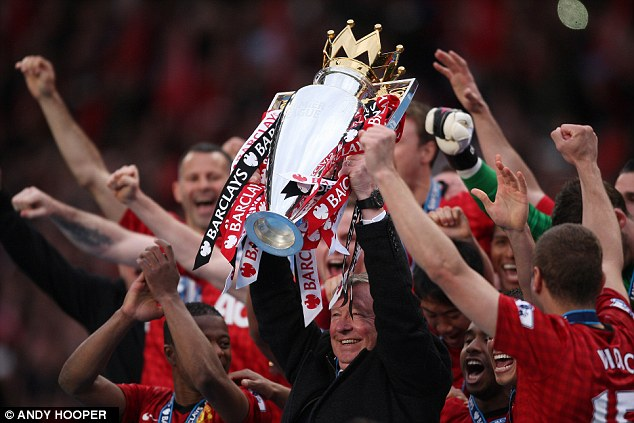 Every success: Fergie lifts the Premier League trophy in 2013, his 13th and final as United boss
