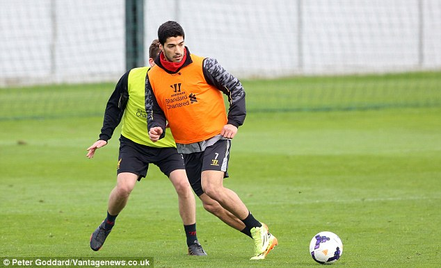 Through their paces: Luis Suarez in training ahead of Liverpool's crunch title clash with Manchester City