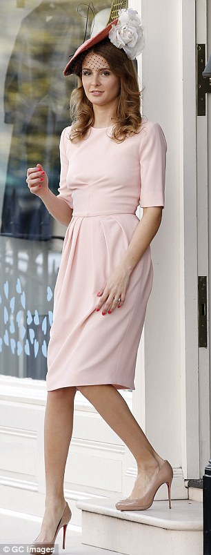 Prim and proper: Millie teamed the £420 Hana dress with a fascinator and leg-lengthening nude heels