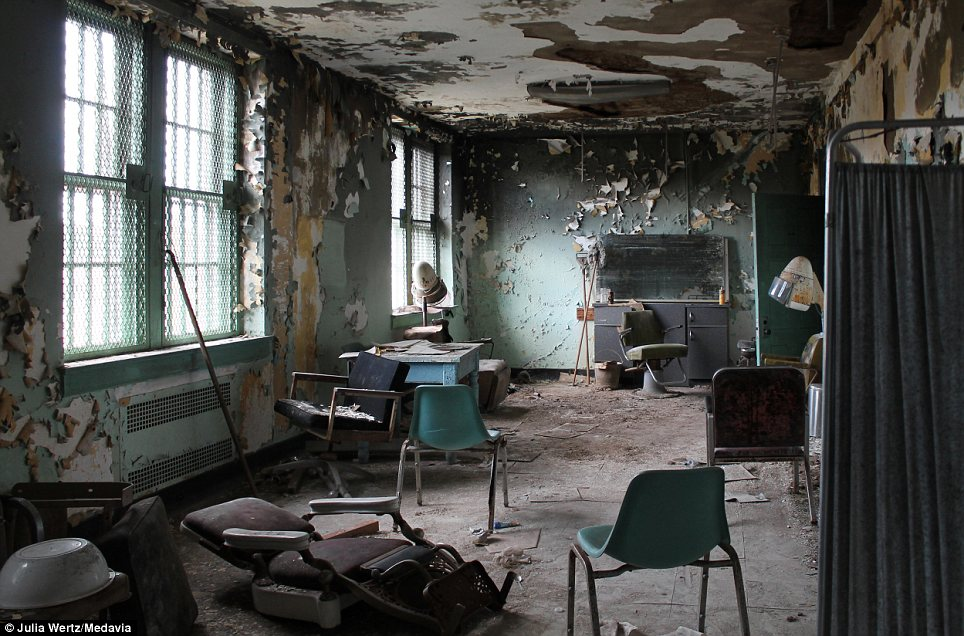 Mould and asbestos: Now unfit for human habitation, this was once the parlour on the self-contained campus where the 7,000 patients could go for a haircut