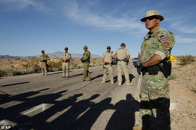 No passage: Federal law enforcement officers block a road into the land Bundy claims is his