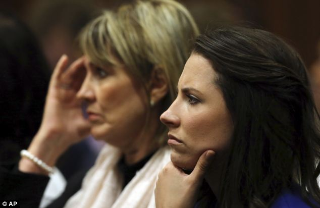 Aimee Pistorius, right, sister of Oscar Pistorius, listens in the public gallery, as state prosecutor Gerrie Nel questions Pistorius in court today