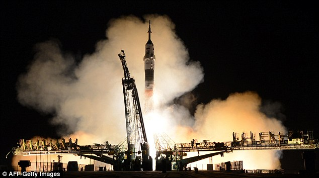 The final frontier: A Russian Soyuz rocket takes off for the International Space Station last month. The Kremlin has announced plans to o build a super-heavy carrier rocket that will propel its cosmonauts to Mars