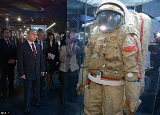 Moon mission: Vladimir Putin (left) looks at exhibits as he visits the Cosmonautics Memorial Museum in Russia. Currently, Russia has plans to launch three lunar spacecraft - two to the surface and one to orbit - by the end of the decade