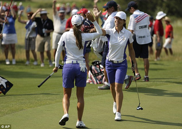 Historic: Spain's Azahara Munoz (left) and France's Karine Icher (right) celebrate during Europe's 2013 win