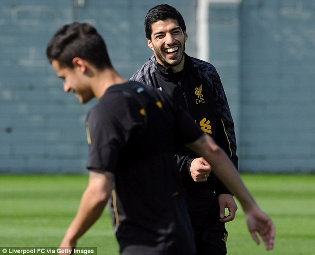 Happy chappy: Suarez cracks up in training ahead of the huge clash against Manchester City on Sunday