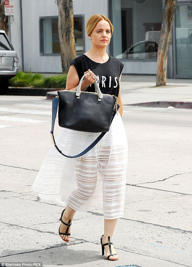Perfectly Parisian: The star looked chic in her T-shirt and 50s style skirt