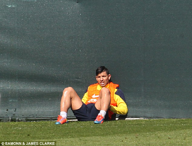 Breather: Aguero takes the opportunity for a rest as he prepares for the Liverpool match