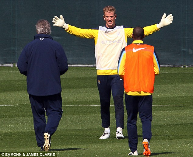 Come here: Manchester City goalkeeper sticks his arms out as his boss Pellegrini walks towards him