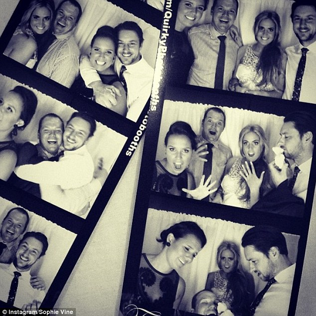 Strike a pose: The foursome smiled and pulled funny faces in a photo booth at the event