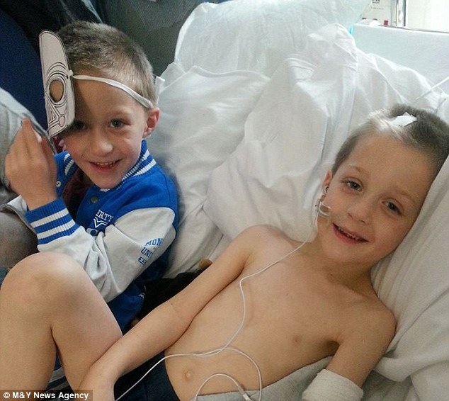 Close: Jack, pictured with his identical twin brother, Liam, left, who walked behind his sibling's coffin at his funeral