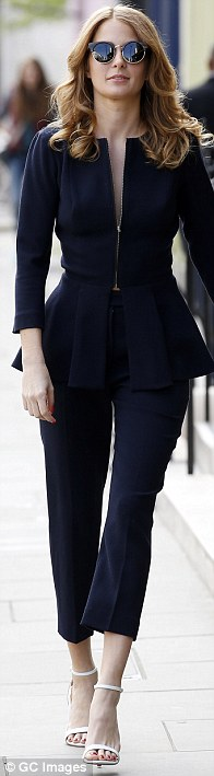 Hot to trot: Millie took the plunge in a wool crepe peplum jacket and matching cigarette pants for another shot