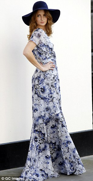 Boho queen: Another outfit Millie wore on the shoot was a stylish floral backless maxi dress and felt hat