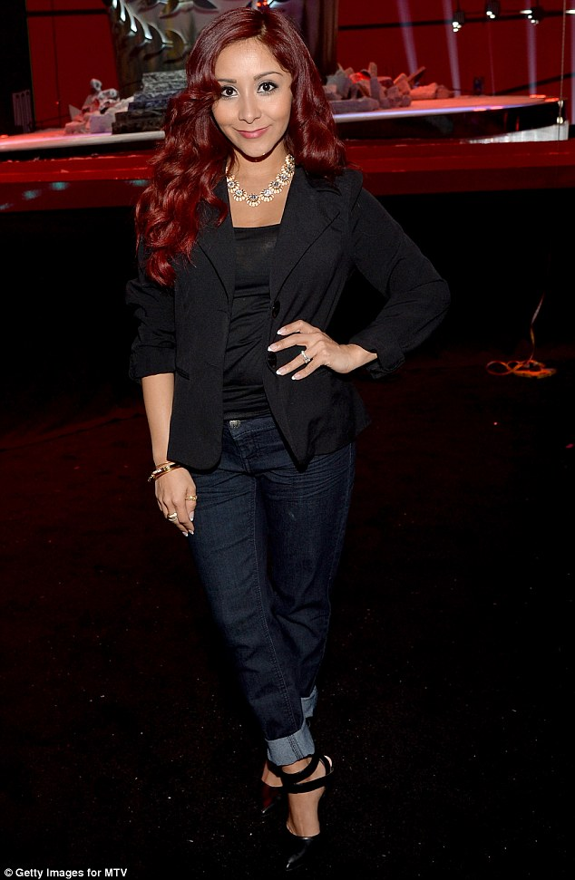 Demure: Earlier in the day Snooki had worn a more formal outfit to an event to promote the 2014 MTV Movie Awards, which take place on Sunday