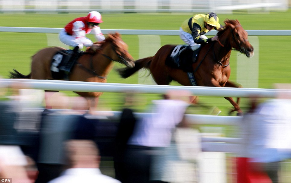 Evita Peron ridden by Jim Crowley (right) on their way to victory in the Coln Valley Stud Bridget Maiden Fillies Stakes during the Dubai Duty Free Weekend at Newbury Racecourse, Berkshire.
