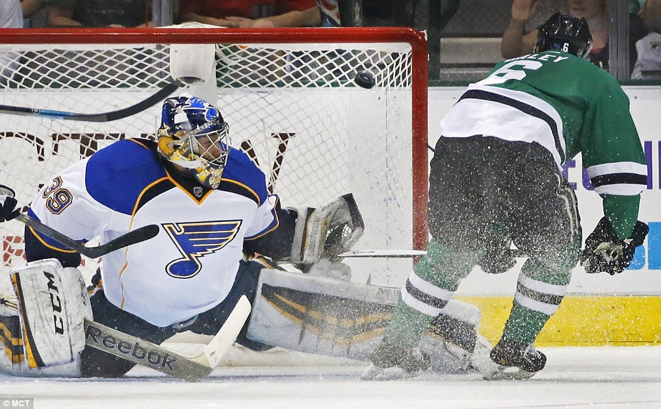 The Dallas Stars' Trevor Daley, right, deposits the puck in the upper right corner of the net in the second period, beating St. Louis Blues goalie Ryan Miller at American Airlines Center in Dallas