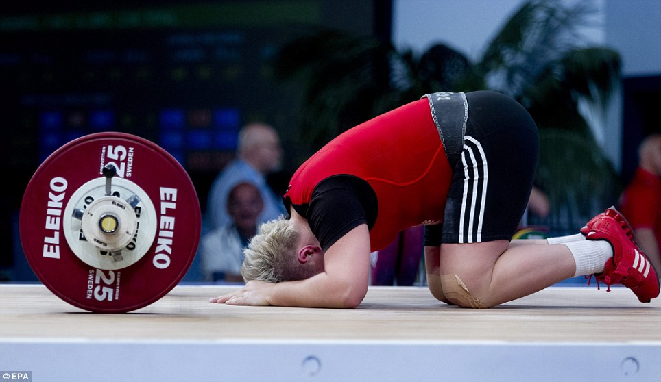 Magdalena Pasko of Poland competes in the women's 75 kg category final at the Weightlifting European Championships in Tel Aviv, Israel