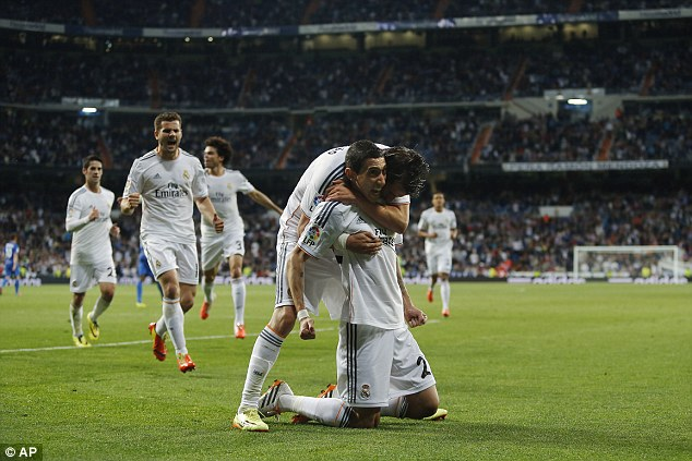 Up and running: Angel Di Maria hit the first in a four-goal rout that puts Real level with city rivals Atletico