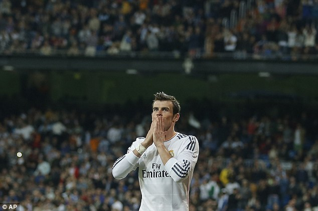 Love affair: Gareth Bale was once again in scintillating form as Real Madrid hammered Granada