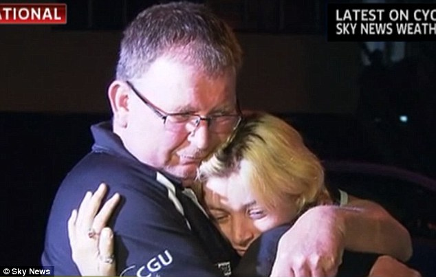 Hug: An emotional Miss O'Donnell embraces her father Rick after her two day nightmare came to an end