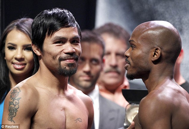 Confidence: Pacquiao of the Philippines poses with undefeated WBO welterweight champion Bradley