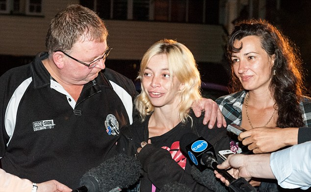 Supported: Tammy is flanked by her family as she speaks to journalists