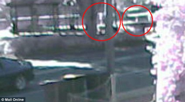 Sighted? Grainy CCTV footage shows two people walking through a car park with what appears to be a young child around 6.20am on Thursday in Childers