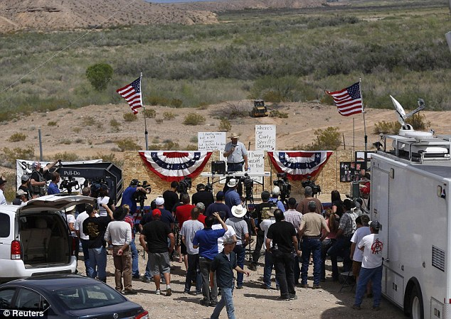Taking a stand: Ammon Bundy (back C), son of rancher Cliven Bundy, talks Friday to protesters at the property