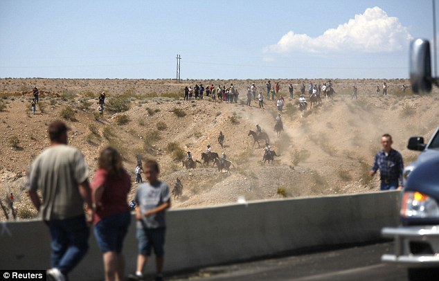 Traffic along the highway has been brought to a standstill as protesters move towards the BLM camp