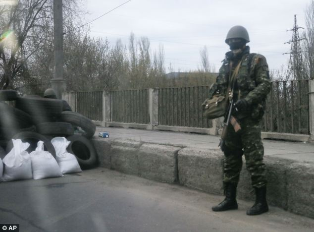 The activists have erected a makeshift checkpoint at the entrance to the eastern Ukrainian town of Slovyansk