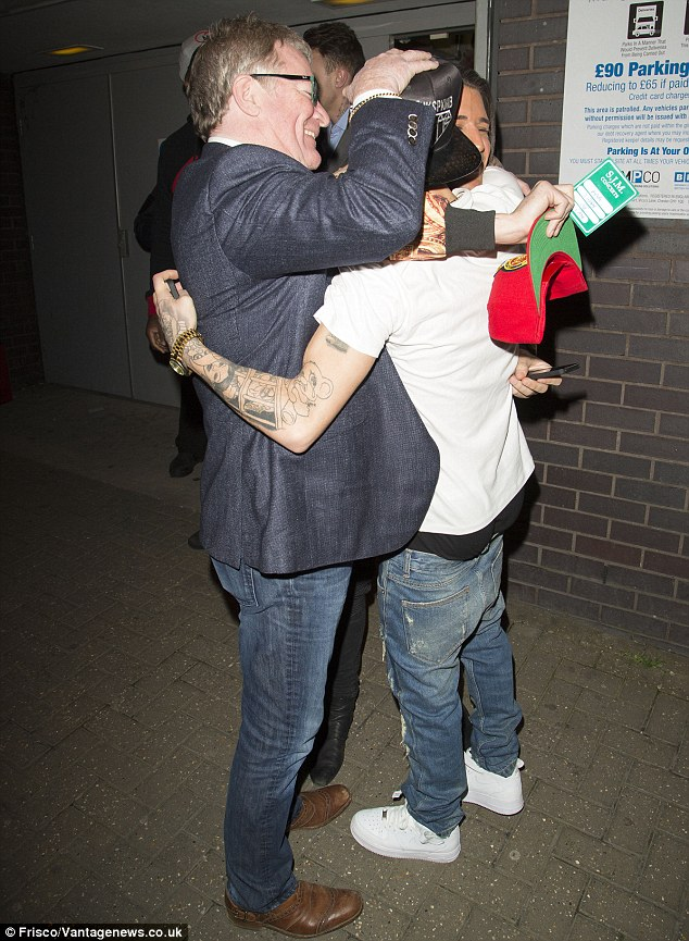 Group hug: Dappy was embraced by Jim and Ollie following his successful show