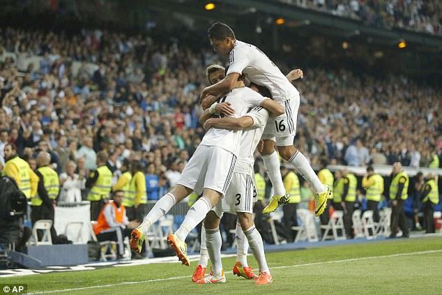 On top: Alvaro Morata, left, celebrates his goal with teammates at the Bernabeu