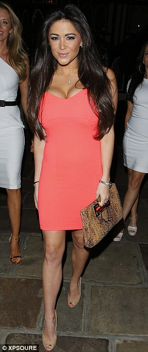 Working it: The model looked stunning in a tight dress that revealed her ample cleavage