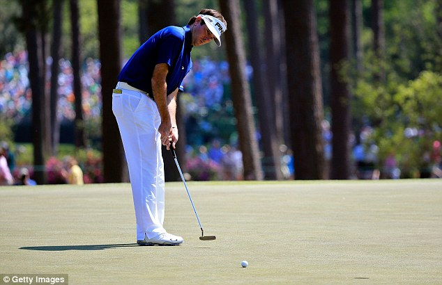 Holding on: Bubba Watson couldn't repeat his stunning Friday performance but still shares the lead