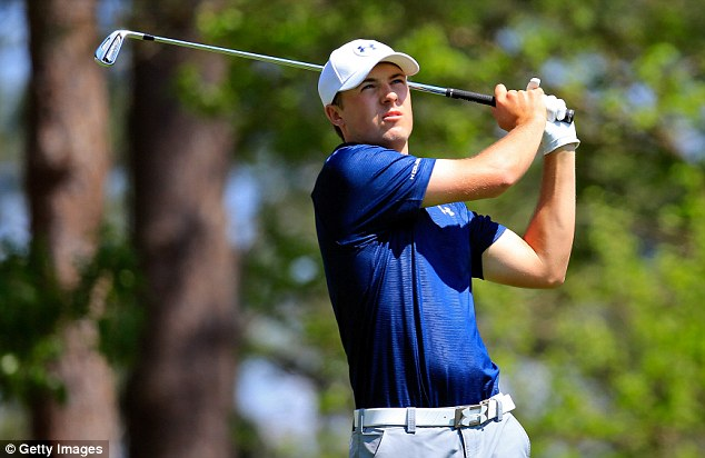 In control: Jordan Spieth watches his tee shot on the fourth hole on his way to shooting a two-under-par 70