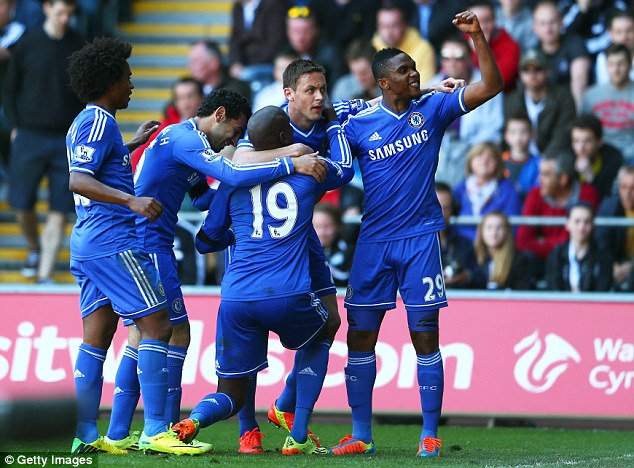 Blues brothers: Chelsea's 1-0 win against Swansea keeps them within two points of leaders Liverpool