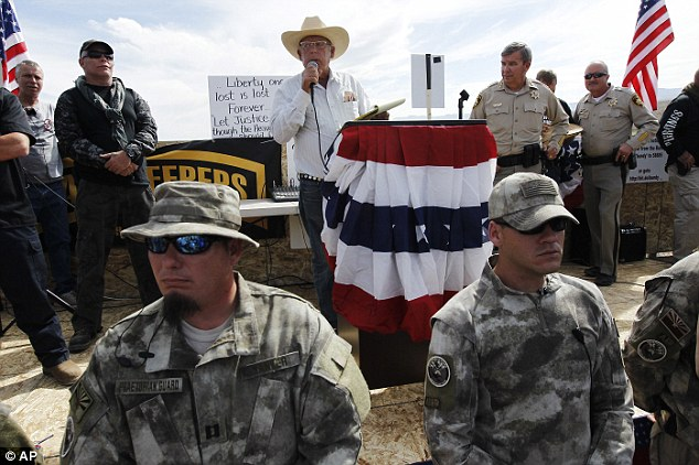 Victory speech: Rancher Cliven Bundy, middle, addresses his supporters along side Clark County Sheriff Doug Gillespie, right, informing the public that the BLM has agreed to cease the roundup of his family's cattle