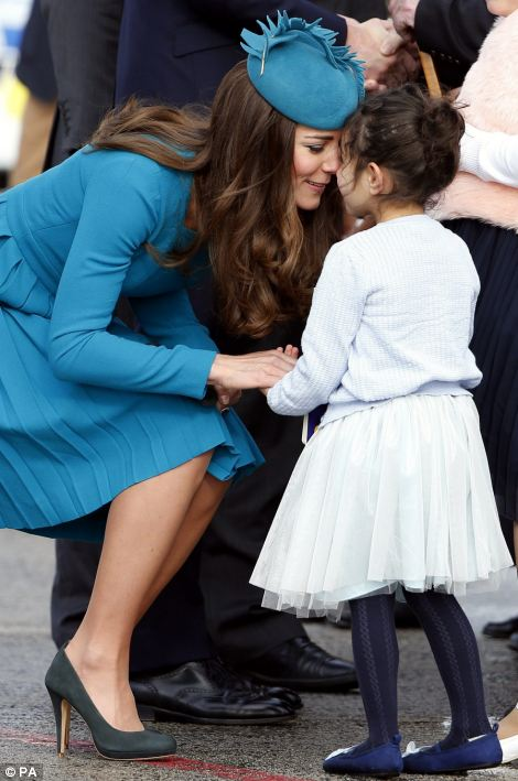 "The Duchess of Cambridge receives a traditional Maori welcome called a ""hongi"" from five-year-old Mataawhio Matahaere Vieint"