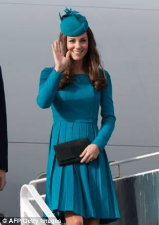 Kate waves as she arrives at Dunedin airport