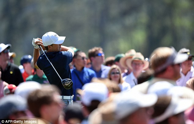 Strong start: Spieth tees off on the first hole on his way to a share of the lead with Watson