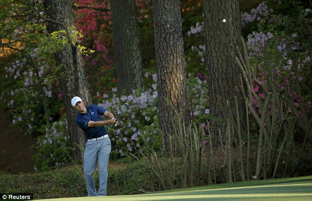 In control: Spieth chips onto the 13th green as he negotiates the last hole on Amen Corner