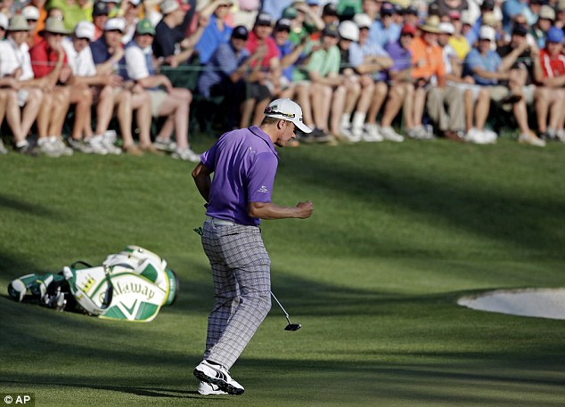 On the up: Jonas Blixt celebrates making a birdie on the 16th on his way to one-under-par round of 71