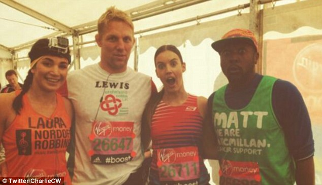 Long way to go: Webster takes a picture with Laura Wright (left) Lewis Moody and Matt Henry (right)