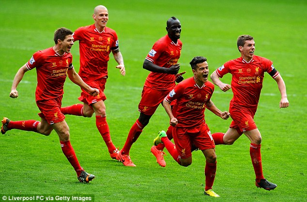 Glory days: Philippe Coutinho celebrates Liverpool's winner with his teammates on Sunday