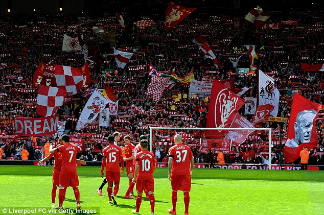 Excitement: Flags and scarves are held aloft on a special day at Anfield as Liverpool beat Manchester City