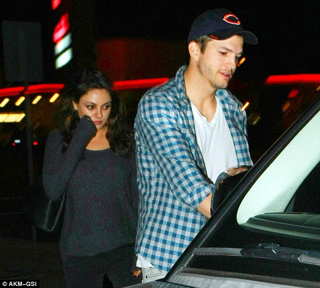 Cravings: Mila Kunis and Ashton Kutcher stepped out for dinner at Umami Burger in Studio City on Saturday